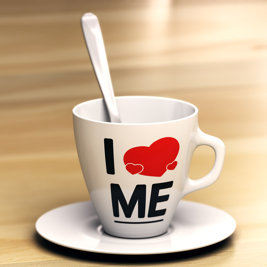 Mug With The Phrase I Love Me On Wooden Table. Concept Of Egocen