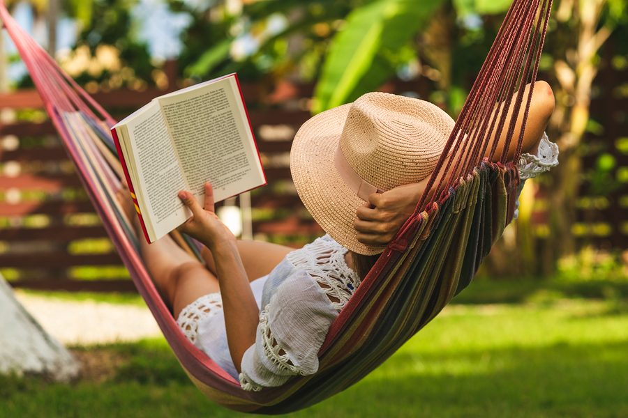 Beautiful Woman Relaxing In Hammock. Beautiful Woman Reading Boo
