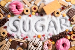 Food Containing Sugar. Mix Of Sweet Donuts, Cakes And Candy With Sugar Spread And Written Text In Un