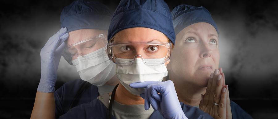 Female Doctor or Nurse Wearing PPE Crying, Praying and Facing Fo