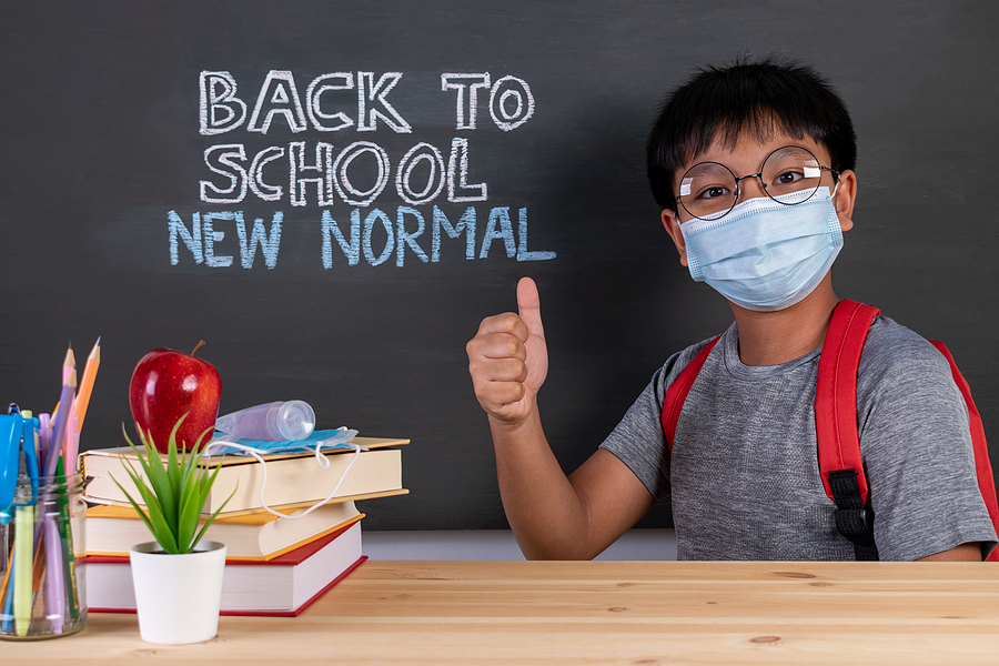 School Boy Wearing Face Mask Thumbs Up Over Blackboard With Text