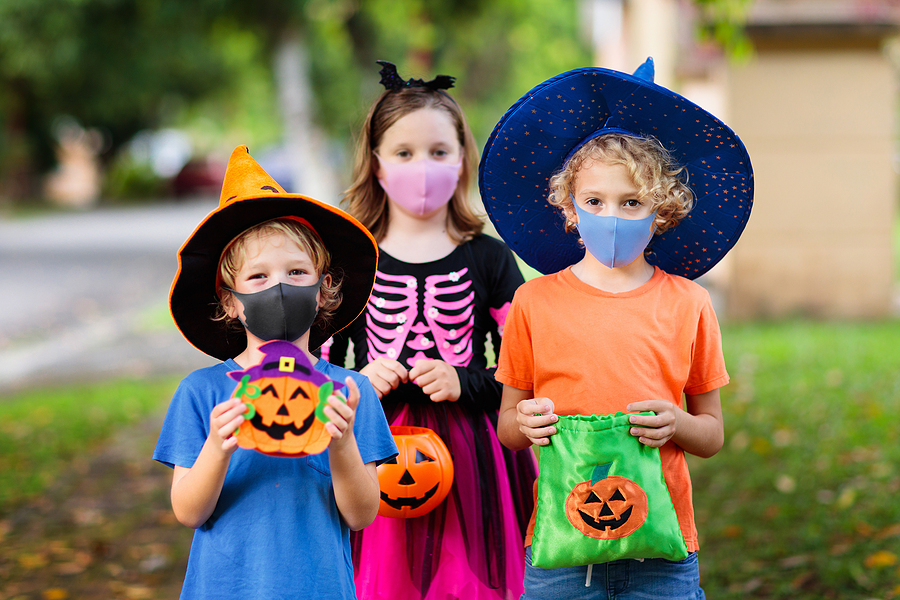 Kids Trick Or Treat In Halloween Costume And Face Mask. Children